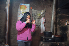 Visionaria photographing a traditional cookstove inside a home in the Cusco Region of Perú (Credit: Chris Carruth)